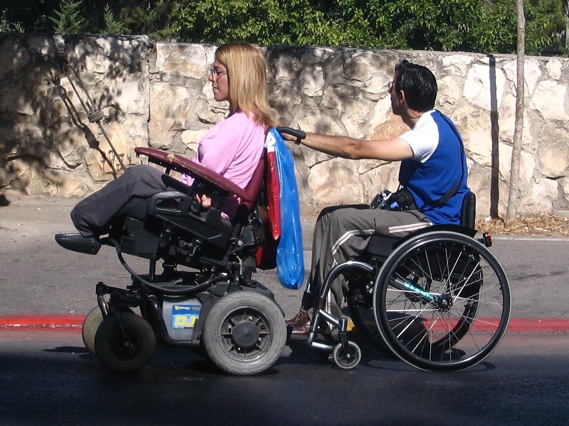 electric wheelchair vs manual wheelchair